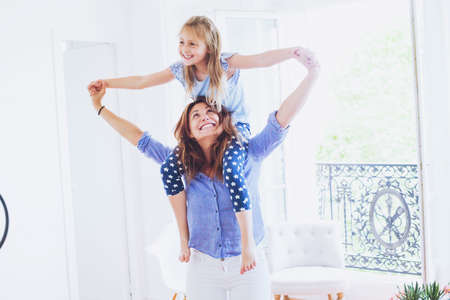 mother and daughter having fun together at home, smiling caucasian family portrait Stock Photo