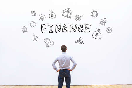 finance concept, business man looking at drawn word on white background Stock fotó