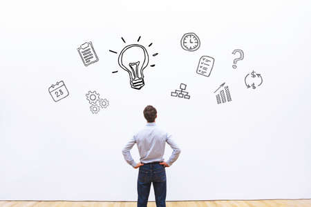 idea or innovation concept, businessman looking at the sketch on white background