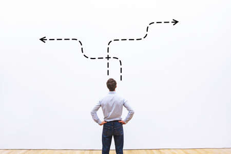 business strategy or decision making concept,  pensive businessman choosing direction 版權商用圖片 - 82501243