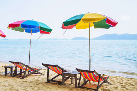 colorful umbrellas and deck chairs on the beach Stock Photo