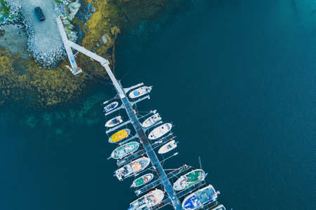 aerial view of the pier and boats from the top from drone