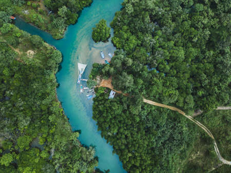 Thailand aerial landscape, drone view of river in green tropical forest, beautiful nature scenery of jungle wilderness
