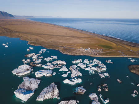 beautiful nature of Iceland, aerial landscape of glacier lake with floating icebergs Фото со стока