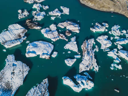 aerial landscape of icebergs in glacial lagoon Jokulsarlon in Iceland, scenic drone view of melting glacier, nature background
