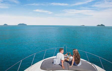 couple drinking champagne on luxury yacht cruise, luxurious lifestyle Stock Photo