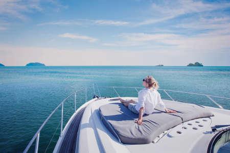 beautiful woman enjoying luxurious yacht cruise, sea travel by luxury boat