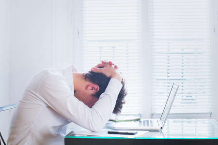 emotional burnout, tired businessman at workplace in the office, stress concept