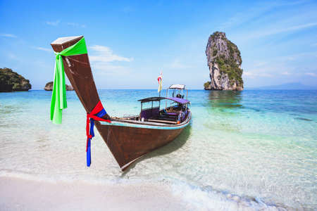beautiful beach in Thailand, paradise landscape with turquoise blue clear water and wooden long-tail boat, summer holiday travel
