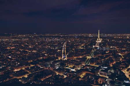 PARIS, FRANCE - AUGUST 29 2015: beautiful night panoramic aerial view of Paris and illuminated Eiffel Tower, city lights Archivio Fotografico