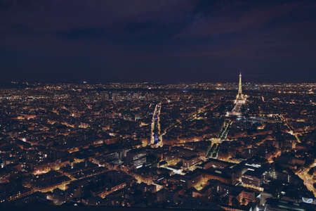 PARIS, FRANCE - AUGUST 29 2015: beautiful night panoramic aerial view of Paris and illuminated Eiffel Tower, city lights Фото со стока