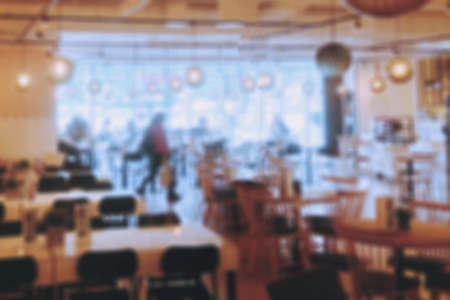 blurred cafe restaurant background, tables with chairs and people eating 스톡 콘텐츠