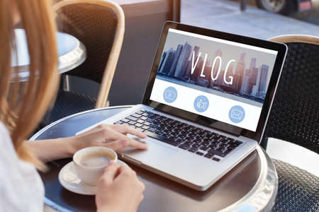 video blog, woman reading vlog online on computer