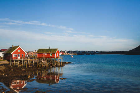 beautiful landscape of Norway, traditional wooden houses with grass roof in fisherman village Reine in Lofoten islands Stock Photo
