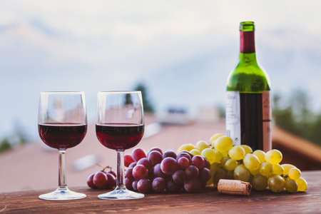 two glasses of red wine in restaurant, background Stock Photo
