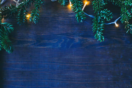 blue cold christmas background with cozy yellow lights and copyspace Archivio Fotografico