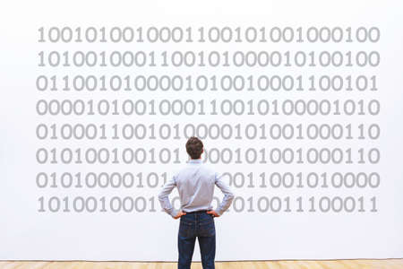 man programmer looking at binary code, coding concept, data encryption