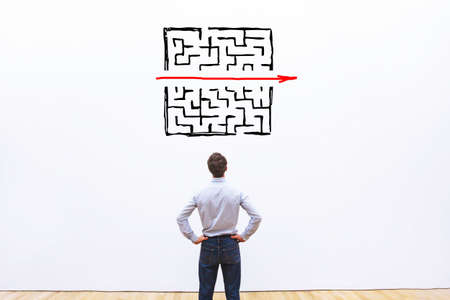 problem and solution concept, business man thinking about exit from complex labyrinth