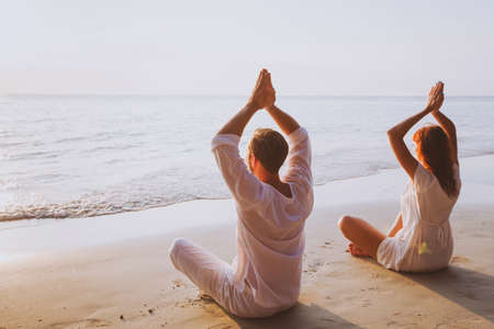 group meditation, yoga on the beach at sunset