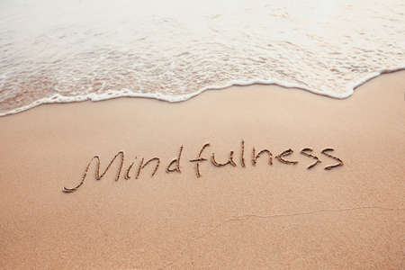 mindfulness concept, mindful living, text written on the sand of beach Imagens - 111082421