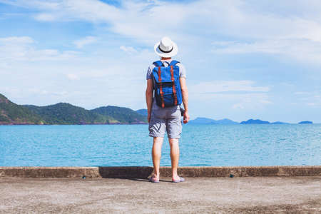 tourist traveler with backpack ready for new travel adventure, background with copy space Stock Photo