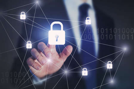 internet network security concept, business man touching lock on virtual screen, protection against cyberattack