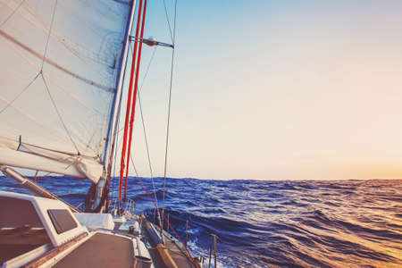 romantic cruise onboard of sailling boat, luxury yacht, beautiful seascape background Foto de archivo