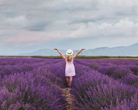 inspiration and creativity concept, woman in inspiring landscape of lavender fields in France