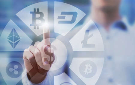 business man pressing buttons with bitcoin, litecoin and ethereum on virtual touch screen interface, digital money concept, cryptocurrency