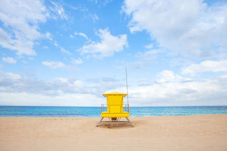 minimalist landscape of beach with yellow hut, colorful scene of sand and blue sky, minimalism