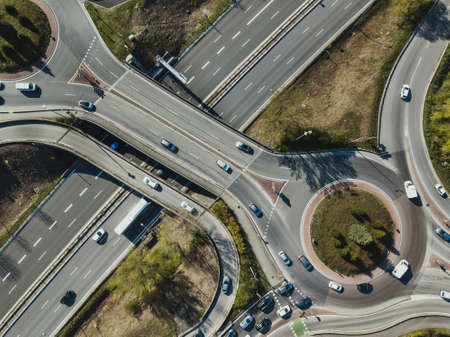 aerial top down view of junction intersection, transportation, cars driving on bridge with roundabout