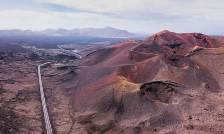 Nature panoramic landscape of volcano craters in Timanfaya national park in Lanzarote island, aerial view of Canary islans, Spain
