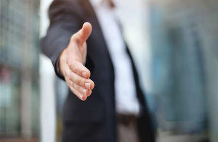business deal proposal, recruitment, businessman offer hand for handshake and cooperation Standard-Bild