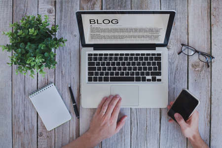 writing a blog, blogger influencer reading text on screen, social media