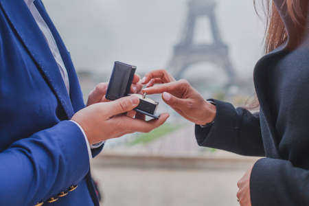 marriage proposal in Paris, wedding in France, hands of romantic couple with engagement ring