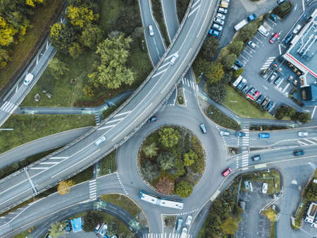 transportation, traffic in urban cityscape from above, cars driving on the road 版權商用圖片