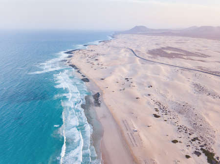 beautiful beach in Canary islands, Fuerteventura, Corralejo aerial view of ocean waves and sand dunes landscape