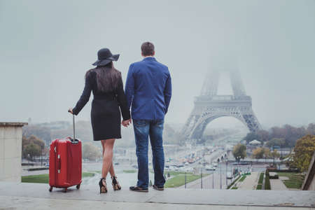 couple of tourists travel to Paris, romantic honeymoon trip, tourism in France