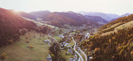 aerial drone panoramic autumn landscape of La Clusaz village, french Alps, mountains in France, Europe