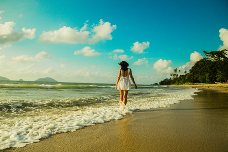 young women from the back walking in the waterfront in El Nido, Lio beach, Palawan province, Philippines