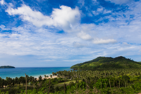 view from the hill to Safari beach on foreground and green palms on background, cloudy sky in Philippines