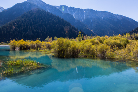 clear water with mountans reflection in Issyk lake in Kazakhstan Stock Photo