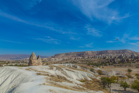 Beautiful Red valley in Cappadocia with cloudy sky in the background Imagens