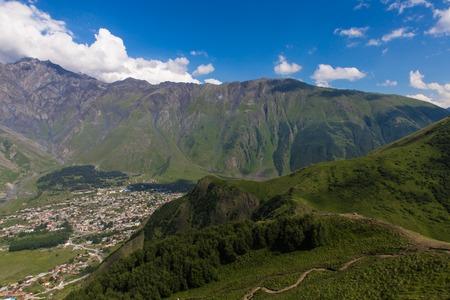 View to Stepantsminde village, Georgia in the summer from Kazbek mountain