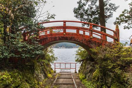 orange torii bridge in Hakone Shrine in Lake Ashi, Japan