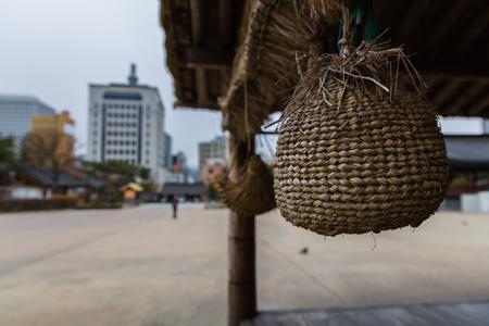 handcrafted basket inside pagoda in traditional Hanok korean village at fall season in Seoul, Korea