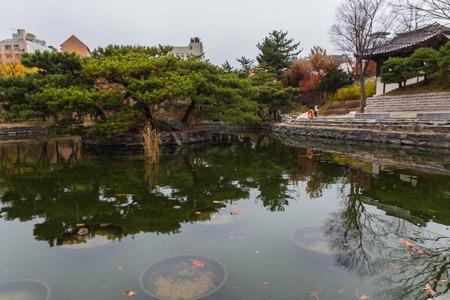 lake view in traditional Hanok korean village at fall season in Seoul, Korea