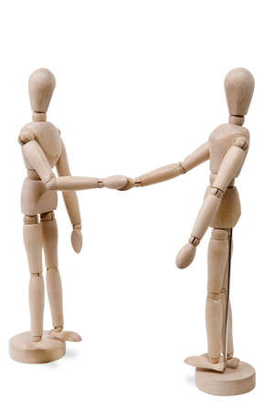 sportsmanship: A pair of wooden figures handshaking isolated on white background.