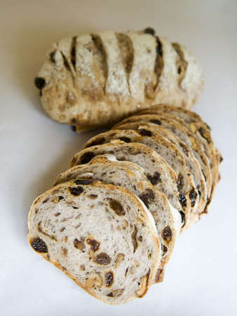 sultana: Sliced traditional golden brown sultana bread loaf. Stock Photo