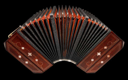 milonga: Bandoneon, half open, isolated on black with path Stock Photo